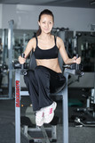 Woman at gym doing exercises to strengthen the abdominal muscles poster