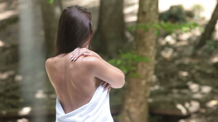 Female back by the waterfall