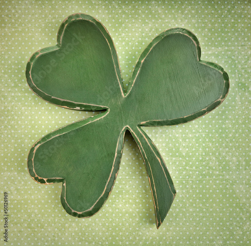 Green  shamrock on vintage polka dot  texture