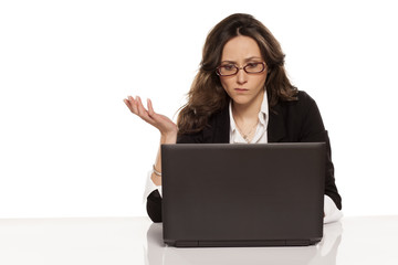 confused girl with a laptop and do not know what to do further