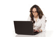 concentrated girl at work on a laptop on white background