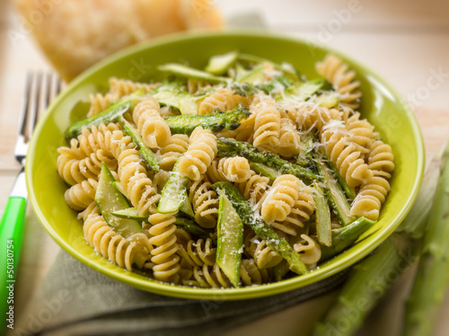 fusilli with asparagus and parmesan cheese, selective focus