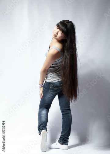 back view of standing young beautiful Asian woman