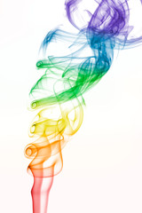 Rainbow colored swirling smoke pattern on white