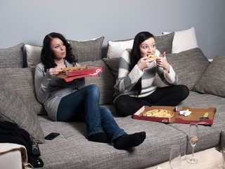 Girlfiriends eating pizza