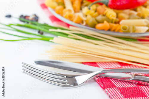 The composition of the pasta and vegetables on background
