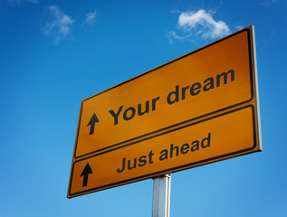 Your dream just ahead road sign.
