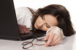 secretary sleeping on her laptop in the workplace on white backg