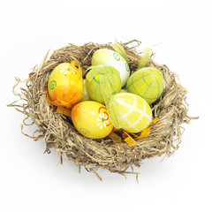 Decorated eggs for Easter in a nest
