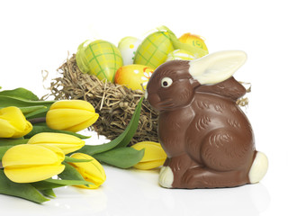 Chocolate rabbit with eggs and Daffodils