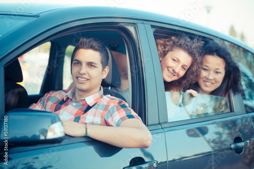 Boys and Girls in a Car Leaving for Vacation