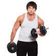 Muscular guy exercises with dumbbell