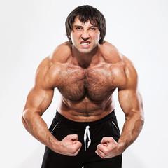 Bodybuilder with naked torso