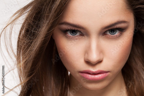 Closeup portrait of young beautiful woman