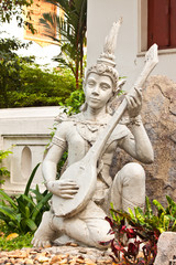 fairy statue with her spinet art of thailand