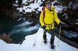 Hiking, snowshoeing - hiker in spring mountains