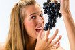 Healthy eating - woman with grapes