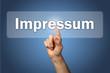 Hand tippt auf Display Impressum