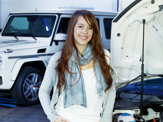 Female customer in a garage is satisfied after service