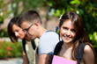 Outdoor portrait of three smiling students