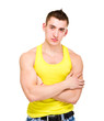 portrait of young beautiful man in yellow t-shirt