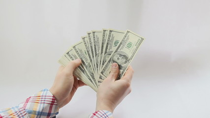 Man counting american dollars on white background