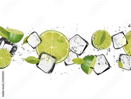 Foto op Canvas In het ijs Limes with ice cubes, isolated on white background