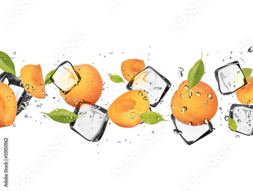 Plexiglas In het ijs Apricots with ice cubes, isolated on white background