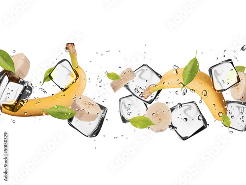 Foto op Canvas In het ijs Banana with ice cubes, isolated on white background