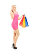 Full length portrait of an attractive woman with shopping bags,