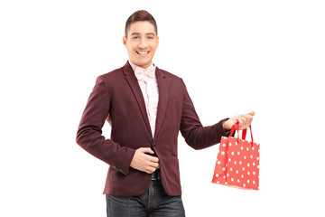 Handsome young man holding a shopping bag