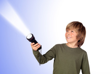 Child with a flashlight looking for something