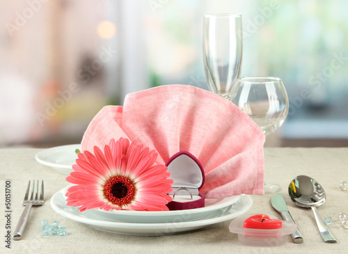 Table serving on bright background