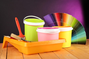 Paint pots, paintbrushes and coloured swatches