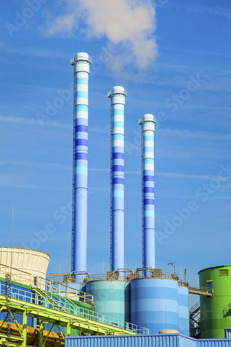 blue chimney in industry plant with smoke