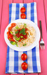 Tasty spaghetti with sauce and vegetables