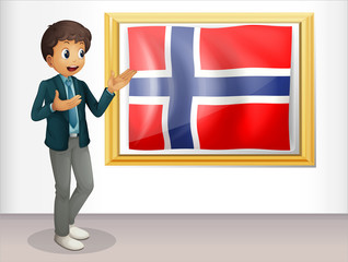 A boy standing beside the flag of Norway