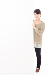 a young asian woman with blank whiteboard