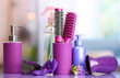 Hair brushes, hairdryer, straighteners and cosmetic bottles in