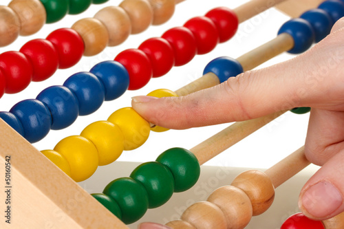 Accountant counting on abacus, close up