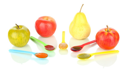 Baby puree in spoons with fruits isolated on white