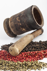 Mortar and pestle with pepper seeds