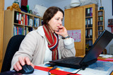 woman is working in the home- office