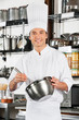 Male Chef With Wire Whisk And Mixing Bowl