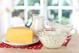 Dairy products on napkin on table in kitchen