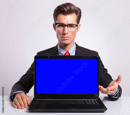 business man presenting laptop