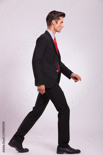 side view of man walking & looking away