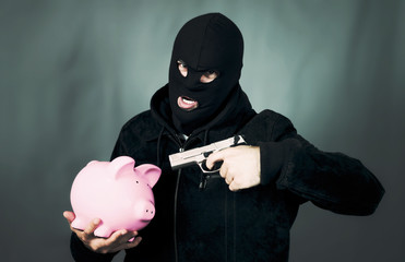 man with a gun and piggy bank