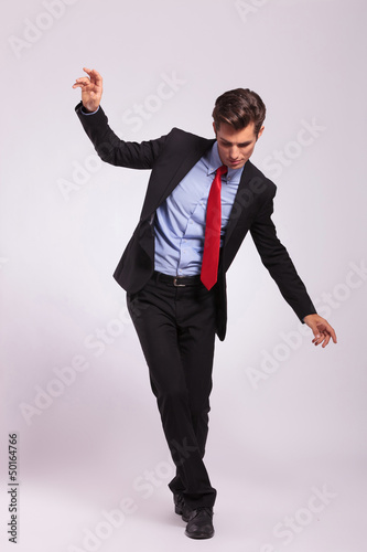 young business man balancing