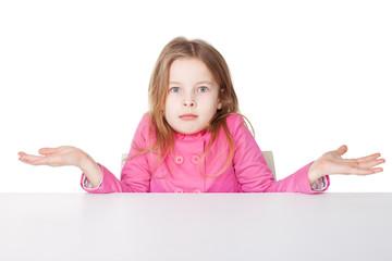 Cute little girl shrugging her shoulders